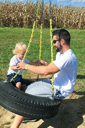 Matt Hostettler and his son swinging